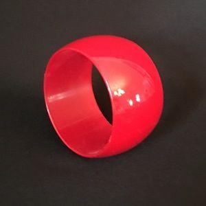 Large red plastic bangle bracelet